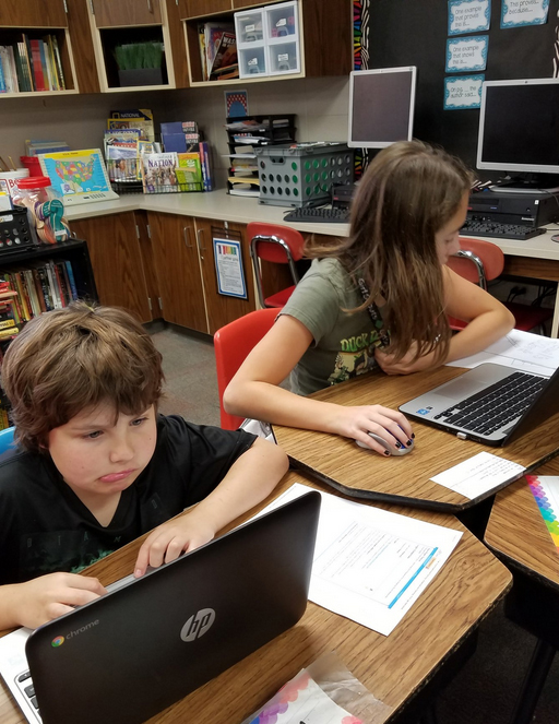 Teacher Ashley Gustin students writing on laptop for Studentreasures